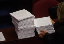 stack of bills at legislature